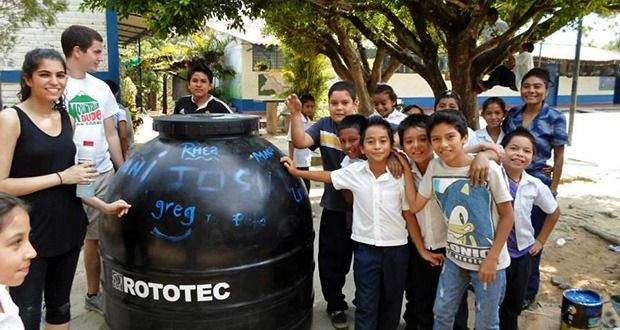 Pure Water Access Project members Rhea Malhotra and Greg Kemper work to bring clean water filters to a school in El Salvador this past March. Credit: Courtesy of PWAP